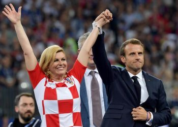 epa06891774 Crotian President Kolinda Grabar-Kitarovic (L) and French President Emmanuel Macron arrive for the award ceremony after the FIFA World Cup 2018 final between France and Croatia in Moscow, Russia, 15 July 2018. France won 4-2.   (RESTRICTIONS APPLY: Editorial Use Only, not used in association with any commercial entity - Images must not be used in any form of alert service or push service of any kind including via mobile alert services, downloads to mobile devices or MMS messaging - Images must appear as still images and must not emulate match action video footage - No alteration is made to, and no text or image is superimposed over, any published image which: (a) intentionally obscures or removes a sponsor identification image; or (b) adds or overlays the commercial identification of any third party which is not officially associated with the FIFA World Cup)  EPA/PETER POWELL   EDITORIAL USE ONLY