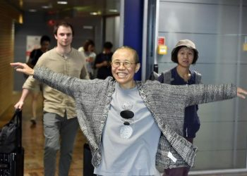 Liu Xia, the widow of Chinese Nobel dissident Liu Xiaobo, gestures she arrives at the Helsinki International Airport in Vantaa, Finland, Tuesday, July 10, 2018. China on Tuesday allowed Liu Xia to fly to Berlin, ending an eight-year house arrest that had drawn intense international criticism and turned the 57-year old poet _ who reluctantly followed her husband into politics two decades ago _ into a tragic icon known around the world.  (Jussi Nukari/ Lehtikuva via AP) [CopyrightNotice: Lehtikuva]