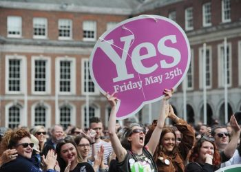 epaselect epa06764757 Supporters of the Yes side celebrate after a referndum on abortion, in Dublin, Ireland, 26 May 2018. According to exit polls, Ireland has voted overwhelmingly to legalize abortion in a historic referendum on 25 May 2018.  EPA/AIDAN CRAWLEY
