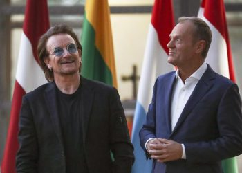 epa07083543 European Council President Donald Tusk (R) welcomes Bono (L), Irish band U2 singer and co-founder of the One campaign in Brussels, Belgium, 10 August 2018. Bono is in Brussels to discuss part of campaign of ONE, an international campaigning and advocacy organisation of more than nine million people taking action to end extreme poverty and preventable disease particularly in Africa.  EPA/OLIVIER HOSLET