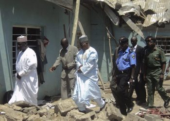 epa02771847 Nigerian governor of Borno state Kashim Shettima (L) walks with officials as they inspect the site of a bomb blast the day after it devastated Saint Patrick Catholic church in Maiduguri northern Nigeria, 08 May 2011. At least five people were killed after blasts at police stations and a church in the northern Nigerian city of Maiduguri on 07 May 2011. This is believed to be the latest attacks by the Boko Haram Islamist sect according to Nigerian officials.  EPA/STR