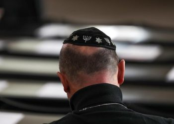 epa07153034 A participant wearing a kippa attends a commemoration ceremony in Paul's Church (Paulskirche) in Frankfurt am Main, Germany, 09 November 2018. The year 2018 marks the 80th anniversary of the Kristallnacht, also known as Night of Broken Glass, a pogrom against the Jewish community that took place on the night from the 09 to the 10 of November 1938. SA (Sturmabteilung) paramilitary forces attacked, ransacked and burnt Jewish-owned stores, buildings and synagogues throughout Germany.  EPA/ARMANDO BABANI