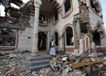 epa07135369 A Yemeni stands amongst debris of a destroyed building allegedly targeted by a previous Saudi-led airstrike, in Sana'a, Yemen, 01 November 2018. According to reports, the US has called for a ceasefire in Yemen and a return to UN-backed peace talks aimed at ending the three-and-half-year conflict between the Saudi-backed Yemeni government and the Houthi rebels.  EPA/YAHYA ARHAB