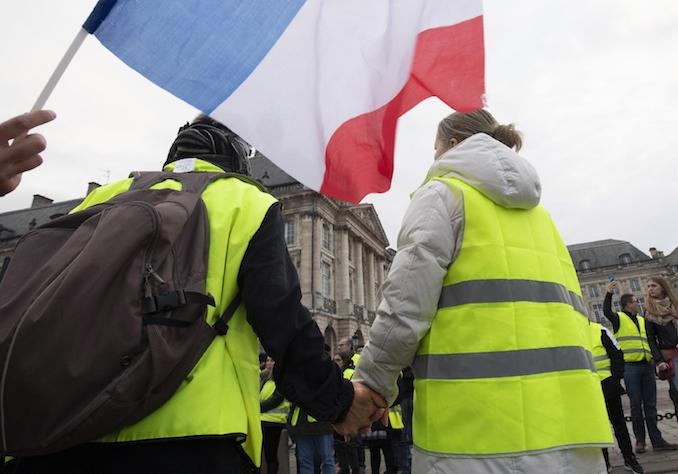 epa07217918 Protesters wearing yellow vests (gilets jaunes) demonstrate in Bordeaux, France, 08 December 2018. The so-called 'gilets jaunes' (yellow vests) are a protest movement, which reportedly has no political affiliation, is protesting across the nation over high fuel prices. Recent demonstrations of the movement, which reportedly has no political affiliation, had turned violent and caused authorities to close some landmark sites in Bordeaux this weekend.  EPA/CAROLINE BLUMBERG