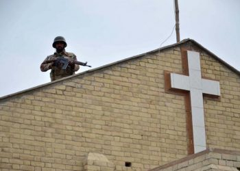 epaselect epa06405320 A Pakistani soldier stands guard at Methodist Church, that was attacked a week earlier by Islamic State (IS) militants, as the Christians minority celebrate Christmas, in Quetta, Pakistan, 25 December 2017. Pakistani Christians were celebrating Christmas Eve Sunday with mass and processions under heavy security, amid fear and challenge of extremists, following a recent attack at a church killing nine people and injuring 57 in the western part of the country. Pakistan is a Sunni Muslim-majority country, with 4 million Christians out of a total population of around 200 million residents.  EPA/STR