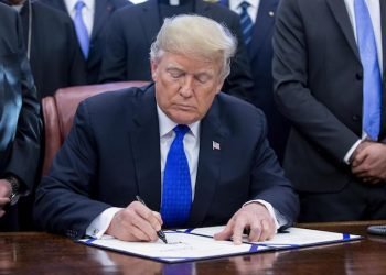 epa07224609 US President Donald J. Trump signs H.R. 390, the 'Iraq and Syria Genocide Relief and Accountability Act of 2018', in the Oval Office of the White House in Washington, DC, USA, 11 December 2018. The law will provide emergency humanitarian and recovery assistance to victims of crimes against humanity, war crimes and genocide in Iraq and Syria. The legislation also directs the US State Department to preserve evidence of genocide in those regions.  EPA/MICHAEL REYNOLDS