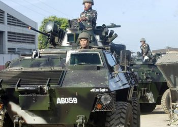 epa07262916 Philippine government troops on armoured vehicles conduct a patrol during a meeting between Moro Islamic Liberation Front (MILF) chairman Al Haj Murad Ebrahim and Presidential Adviser on the Peace Process (OPAPP) Secretary Carlito Galvez Junior (both not pictured) in Jolo town, in the volatile island of Sulu, southern Philippines, 05 January 2019. According to reports, over two million people in the Muslim provinces of Basilan, Sulu, Tawu-Tawi, Maguindanao and Lanao del Sur are expected to join a plebiscite, on January 21, to ratify the passage of the Bangsamoro Organic Law (BOL). The law aims to give Muslims in the southern Philippines a full control of the autonomous region, where they will be allowed to form an elected parliament and administration in Islamic-majority areas.  EPA/BEN HAJAN