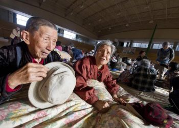 epa05263818 Eighty-eight year old Tsuto and Hatsuyo Nagata rest in a village evacuation center, following a series of earthquakes in Minami Aso, Kumamoto Prefecture, southwestern Japan, 17 April 2016. At least 41 people were killed and over 1,000 injured in the series of earthquakes hitting southwestern Japan since 14 April 2016. Rescue operations are in full force in a search for residents still missing in the mountain village.  EPA/EVERETT KENNEDY BROWN