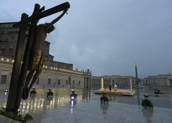 """This handout photo provided by the Vatican Media shows Pope Francis delivering an extraordinary """"Urbi et Orbi"""" blessing, normally given only at Christmas and Easter, from an empty St. Peter's Square, as a response to the global coronavirus disease (COVID-19) pandemic, Vatican City, 27 March 2020. ANSA/ VATICAN MEDIA +++ HO - NO SALES, EDITORIAL USE ONLY +++"""