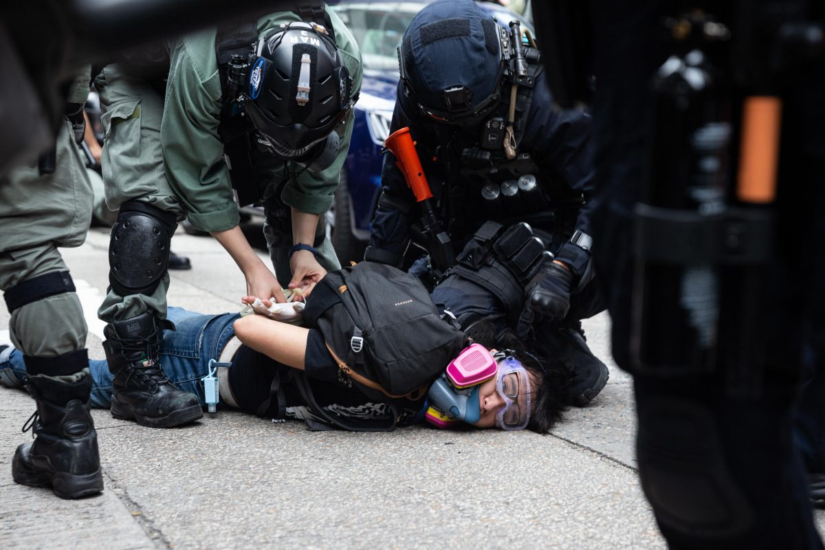 epaselect epa08440822 Police detain a protester during a rally against the implementation of the national security law in Hong Kong, China, 24 May 2020. Beijing unveiled a resolution at the opening of its annual legislative sessions that will bypass Hong Kong's legislature to outlaw acts of secession, subversion and terrorism in Hong Kong.  EPA/JEROME FAVRE