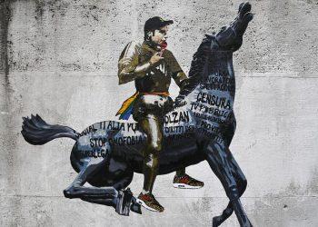 """A Roma lo street artist Harry Greb ha dedicato un murales a Fedez e al suo discorso al Concertone su ddl Zan, omofobia, censura eccetera. S'intitola """"Non è la Rai"""""""
